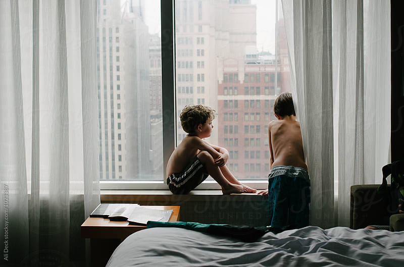 Boys in Hotel Window by Ali Deck for Stocksy United