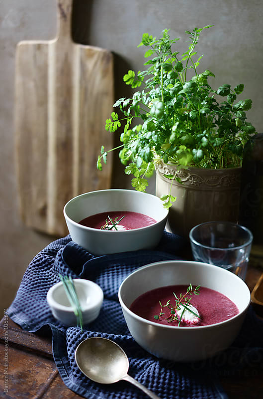 Beetroot soup: Homemade beetroot soup in white bowls. by Darren Muir for Stocksy United