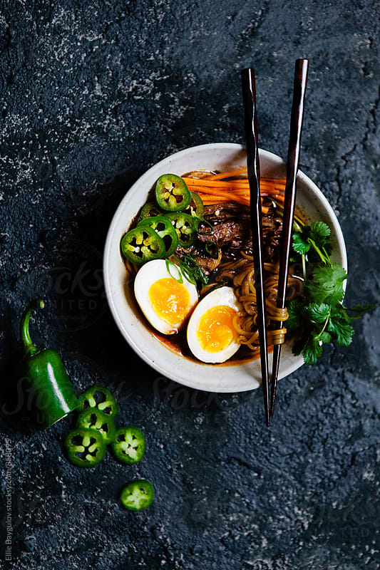 Asian beef noodle soup by Ellie Baygulov for Stocksy United