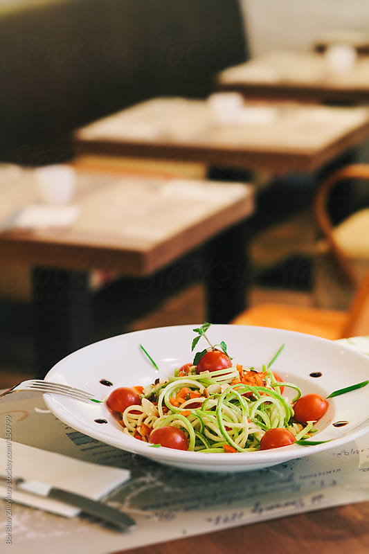 Zucchini Spaghetti with cherry tomatoes and pistachio by Borislav Zhuykov for Stocksy United