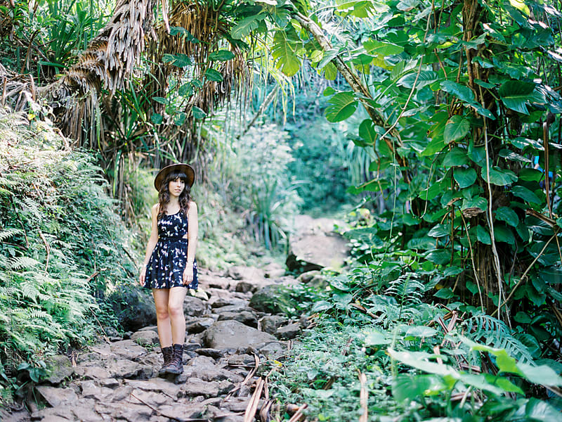 Woman hiking in tropical forest by Daniel Kim Photography for Stocksy United