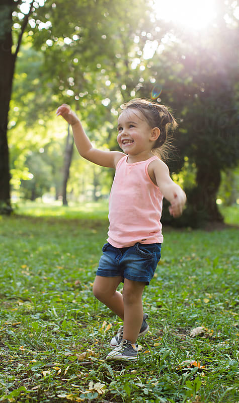 Happy Little Girl Running in the Park by Mosuno for Stocksy United