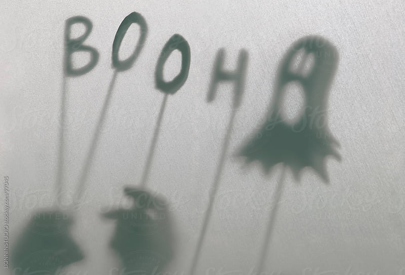 Halloween decoration. Children making terrifying shadow puppets. by BONNINSTUDIO for Stocksy United