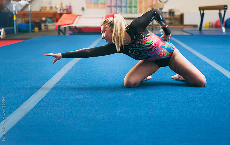 Gymnastics: Teen Female Stops To Pose During Floor Routine by Sean Locke for Stocksy United