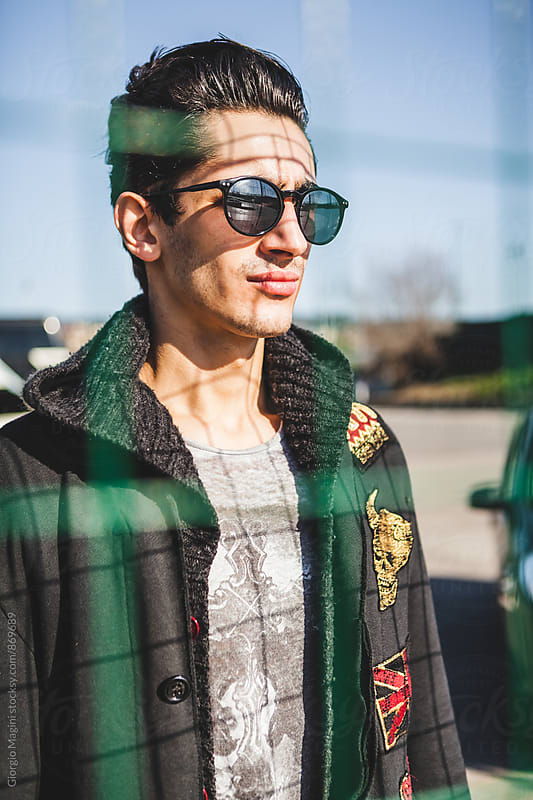 Portrait of a Young Man with Black Coat and Sunglasses by Giorgio Magini for Stocksy United