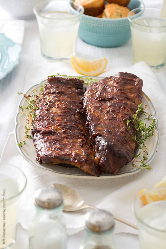 Barbecue Ribs and Corn Dinner Party: Rack of Ribs  by Jeff Wasserman for Stocksy United