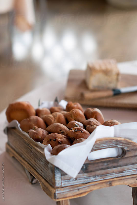 brioches in a wooden box ready for breakfast by Laura Adani for Stocksy United