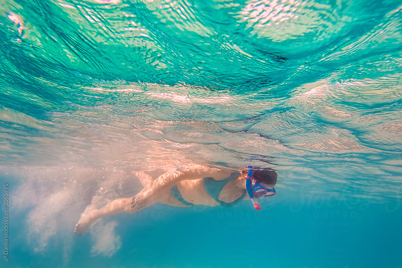 Woman Swimming in Ocean Underwater at All Inclusive Caribbean Resort White Sand Beach by JP Danko for Stocksy United