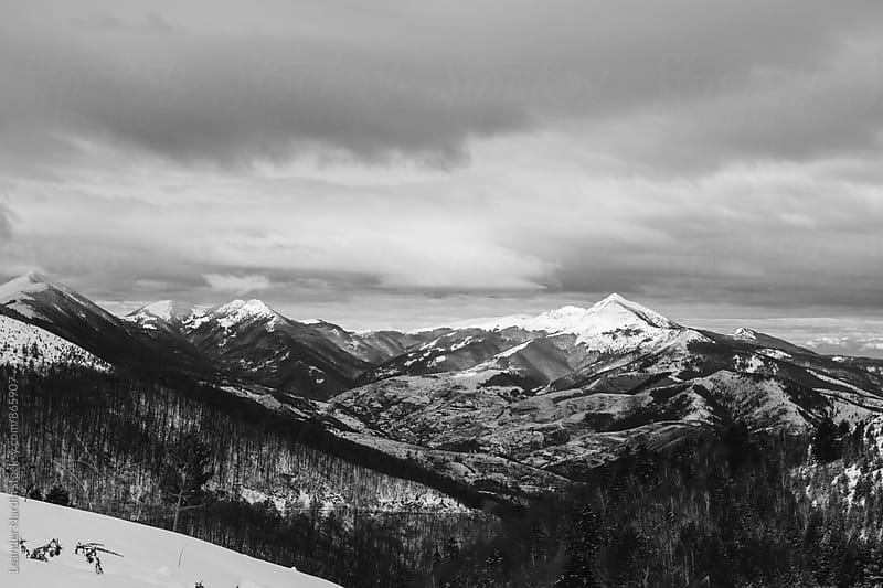 snowcovered mountain landscape in kosovo, black and white by Leander Nardin for Stocksy United