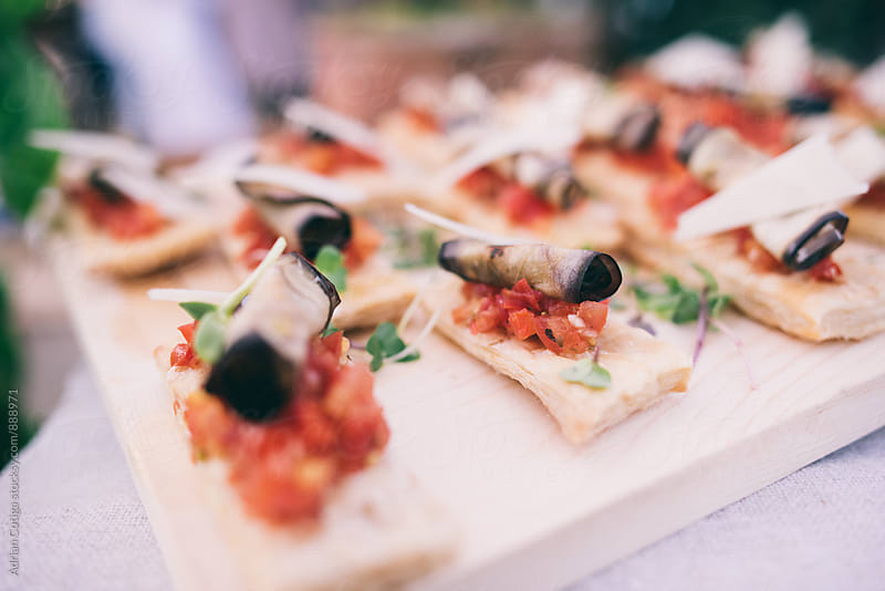 Bruschetta with grilled eggplant, vegan food by Adrian Cotiga for Stocksy United