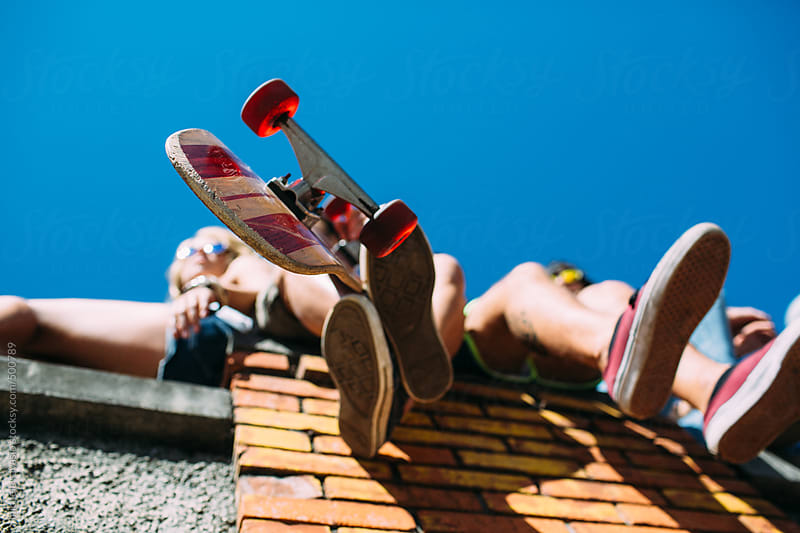 Feet and skateboard by michela ravasio for Stocksy United