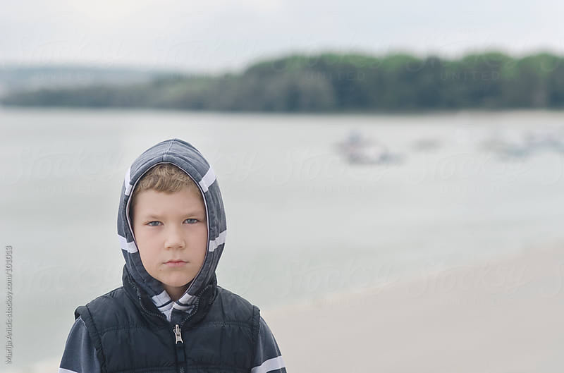 boy looking at the river by Marija Anicic for Stocksy United