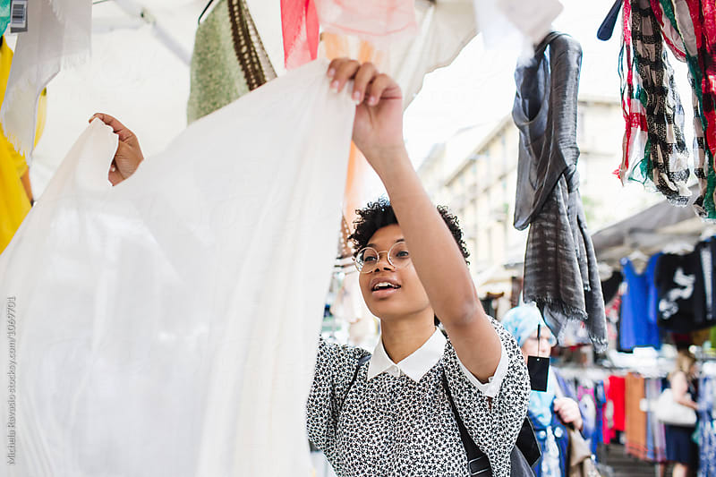 Smiling woman shopping at the marketplace by michela ravasio for Stocksy United