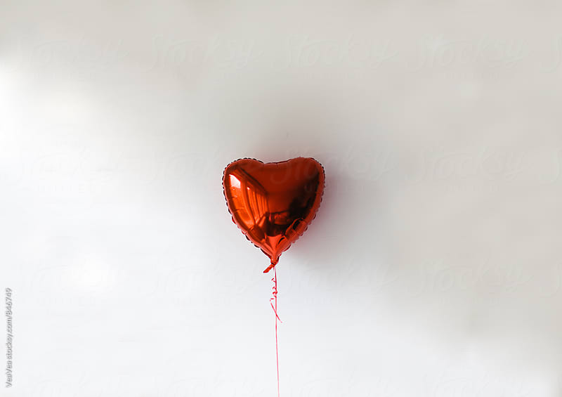 Heart shaped red balloon on the white background by Marija Mandic for Stocksy United