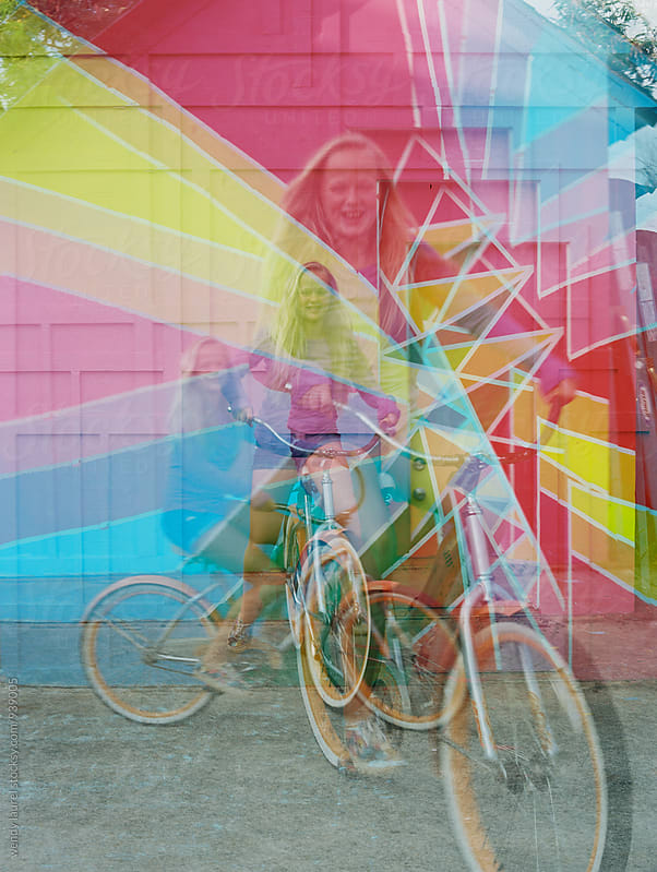 colorful wall wtih girl on bike multiple exposures by wendy laurel for Stocksy United
