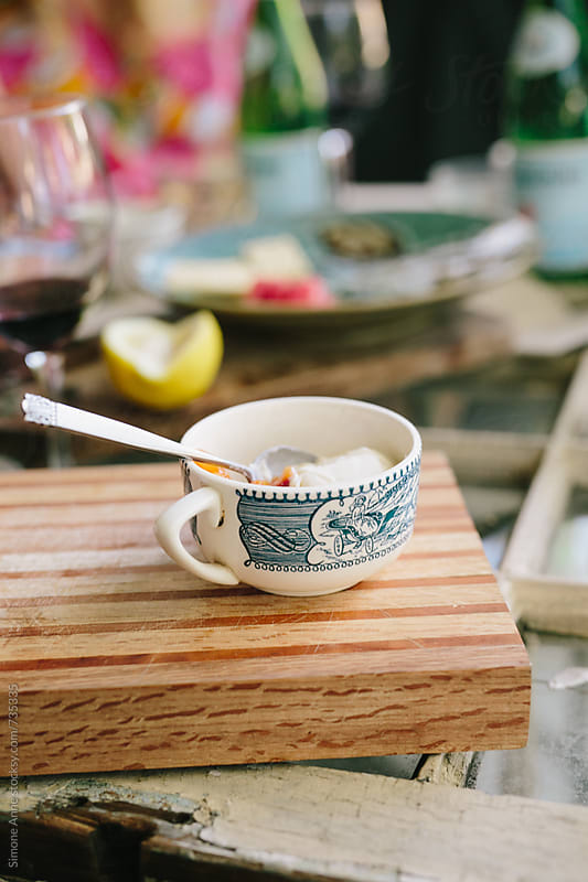 Homemade panna cotta in vintage mug by Simone Anne for Stocksy United