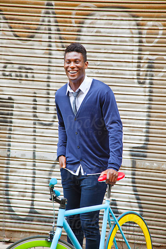 African young man with his bicycle in the city. by BONNINSTUDIO for Stocksy United