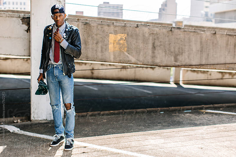 Portrait of a male in street dapper attire by Kristen Curette Hines for Stocksy United