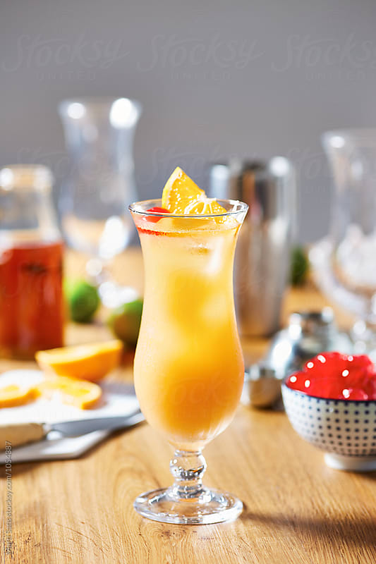 Delicious cocktail with rum,passion fruit syrup and lemon juice by Martí Sans for Stocksy United