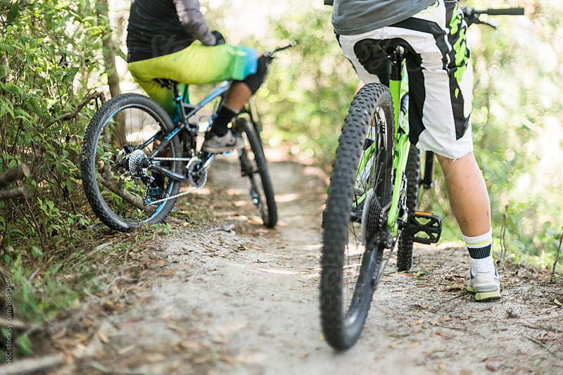 Two Bikers Rest on Mountain Bike Trails by suzanne clements for Stocksy United