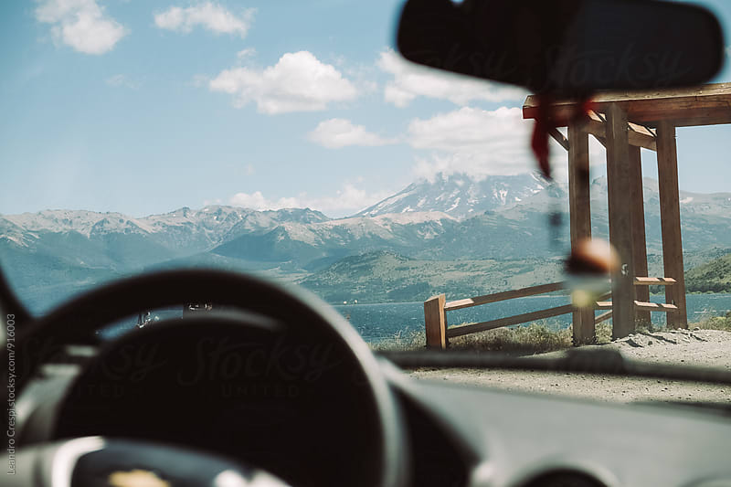View of the mountains from inside a vehicle by Leandro Crespi for Stocksy United