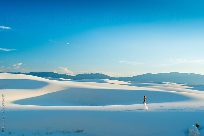 Woman In White Skirt Walking Barefoot Across Sand Dunes In White Sands National Monument New Mexico by JP Danko for Stocksy United
