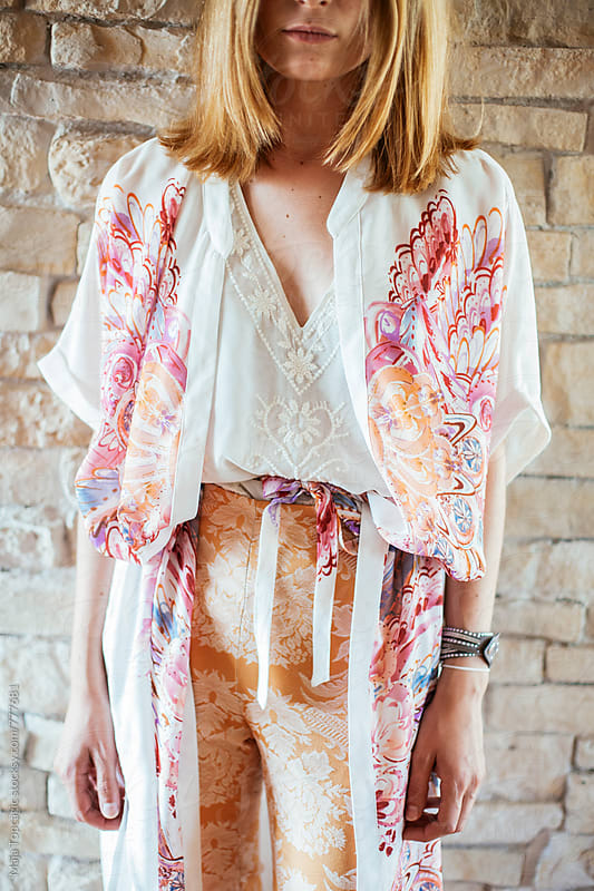 Young beautiful woman in floral pattern clothes by Maja Topcagic for Stocksy United