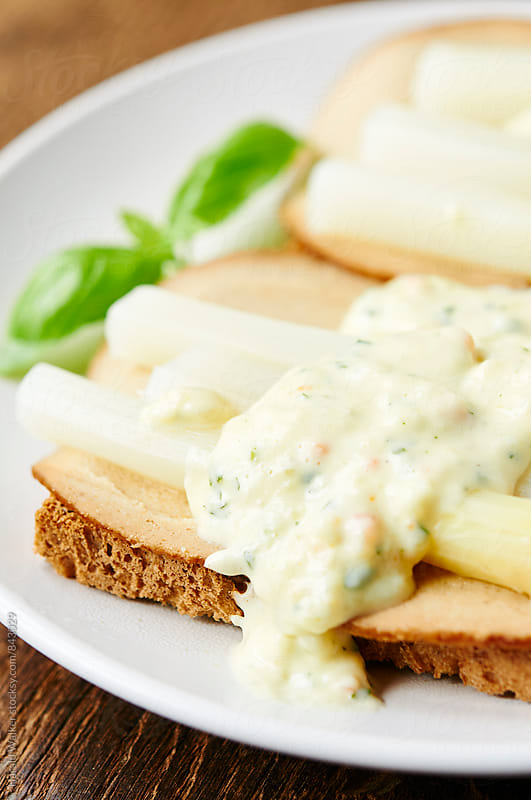 Asparagus on Toast with Creamy Sauce by Harald Walker for Stocksy United
