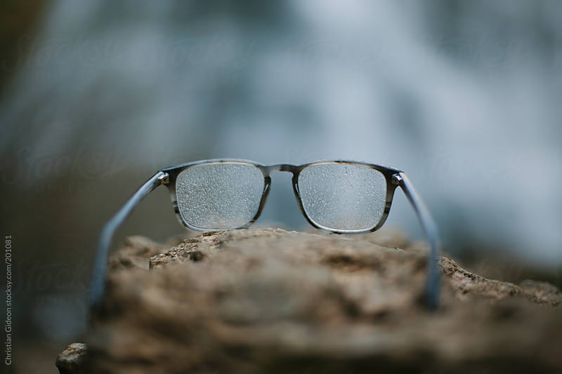 Misty Glasses on a Rock by Christian Gideon for Stocksy United
