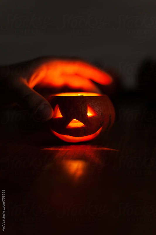 Hand and a small Halloween pumpkin  by Marija Mandic for Stocksy United