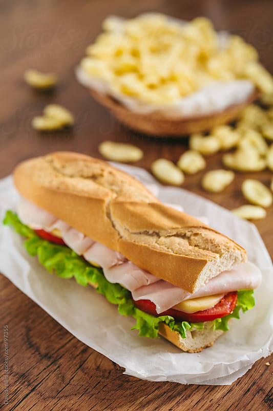 Half baguette sandwich by Davide Illini for Stocksy United