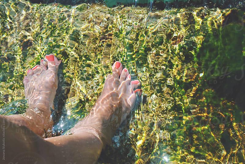 feet in the sea by Jovana Vukotic for Stocksy United