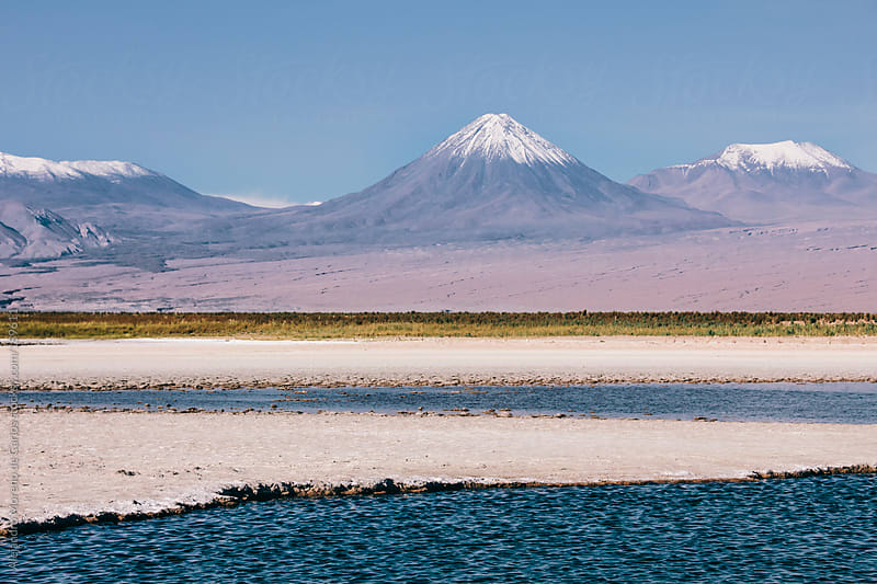 Volcano and mountains landscape with lake - river. Licancabur volcano, San Pedro de Atacama, Chile by Alejandro Moreno de Carlos for Stocksy United