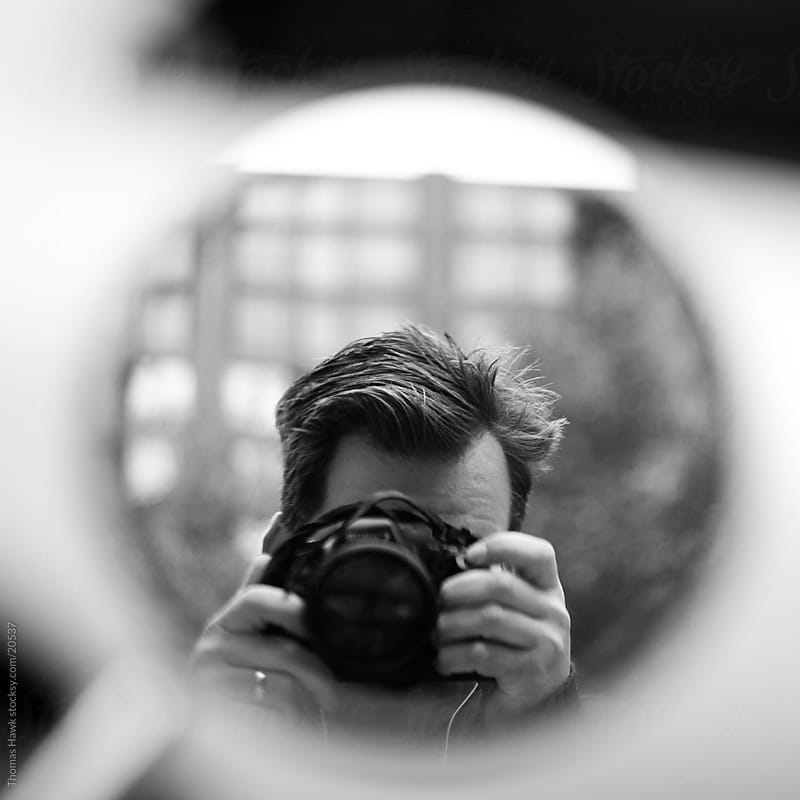 Man with camera in mirror by Thomas Hawk for Stocksy United