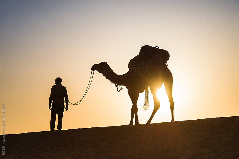 man and his camel in the desert by RG&B Images for Stocksy United