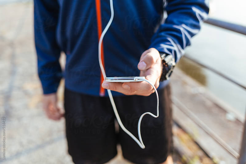 Runner Listening to Music on Mobile Phone by Lumina for Stocksy United