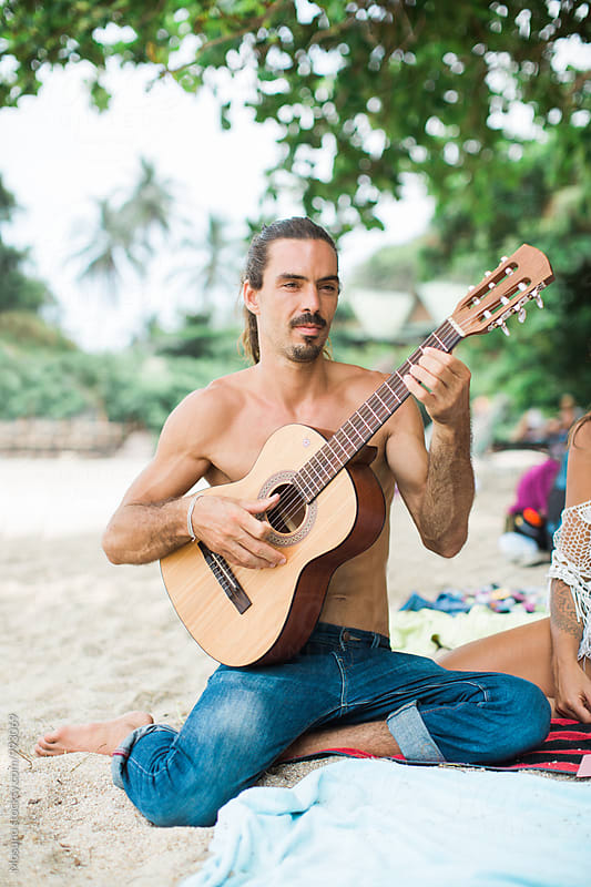 Man Playing Guitar at the Beach by Mosuno for Stocksy United