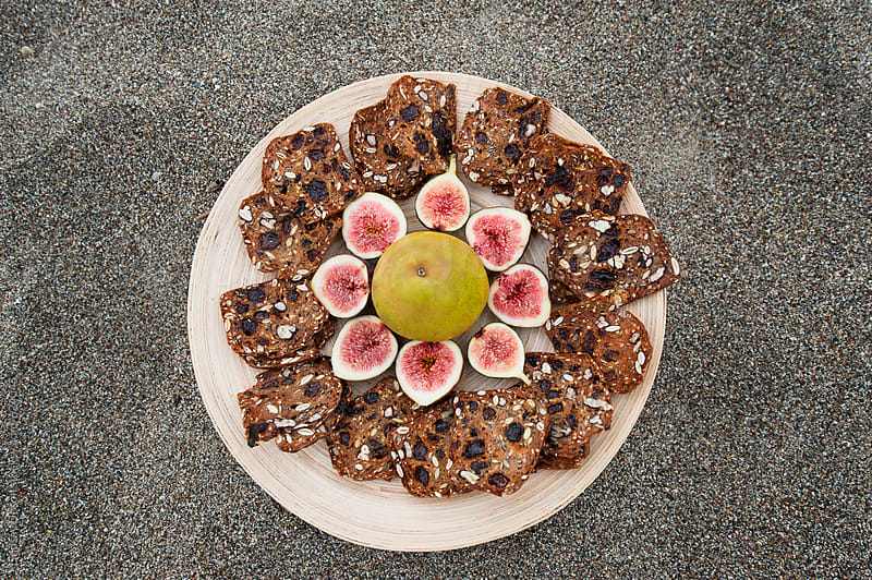 Figs and crackers appetizer by Lindsay Upson for Stocksy United