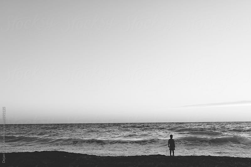 Boy watching the sea. by Dejan Ristovski for Stocksy United