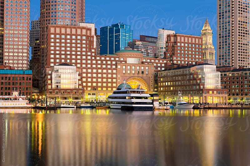 Skyline and inner harbour including Rowes Wharf at dawn, Boston, Massachusetts, New England, United States of America, North America by Gavin Hellier for Stocksy United