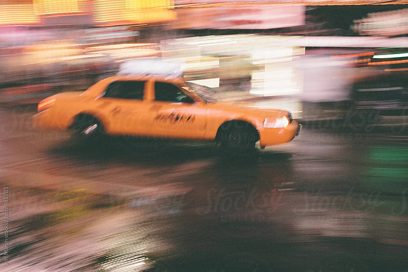 A taxi in motion by Jeff Marsh for Stocksy United