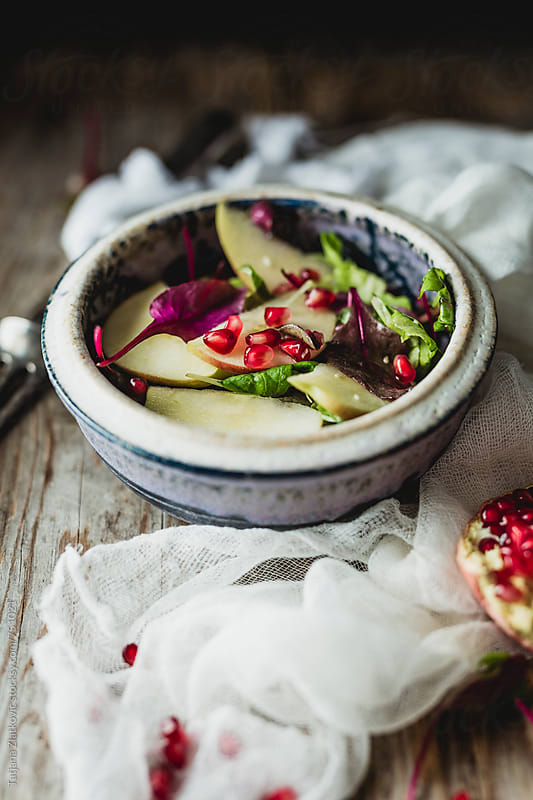 Vegan salad with pomegranate by Tatjana Zlatkovic for Stocksy United