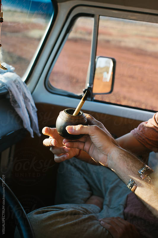 On The Road - Two Men Sharing Mate While Driving Camper Van by Julien L. Balmer for Stocksy United