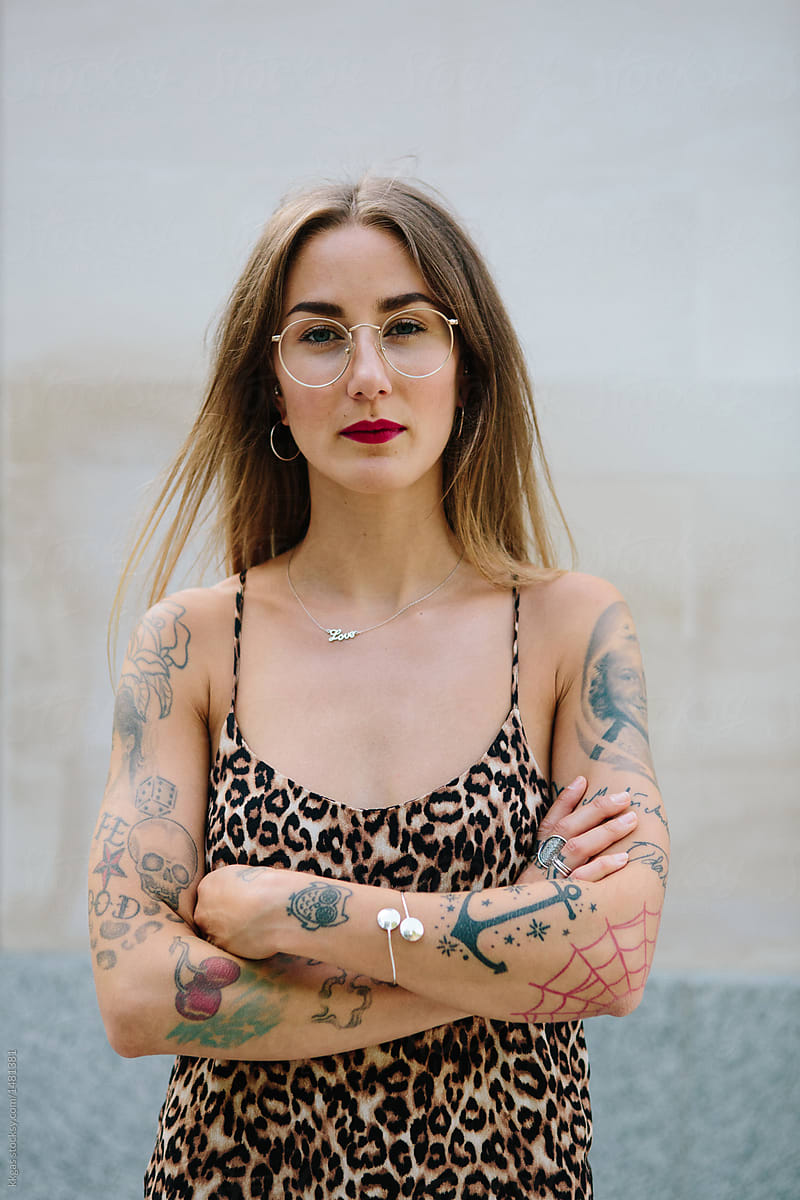 Attractive Heavily Tattooed Woman With Arms Crossed Looking