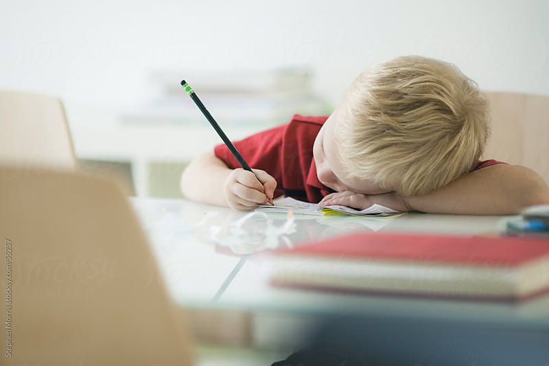 Boy Doing Homework by Stephen Morris for Stocksy United