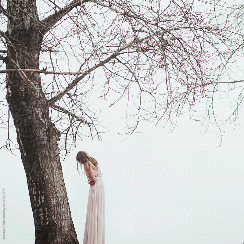 Girl standing in a long pink dress by Jovana Rikalo for Stocksy United
