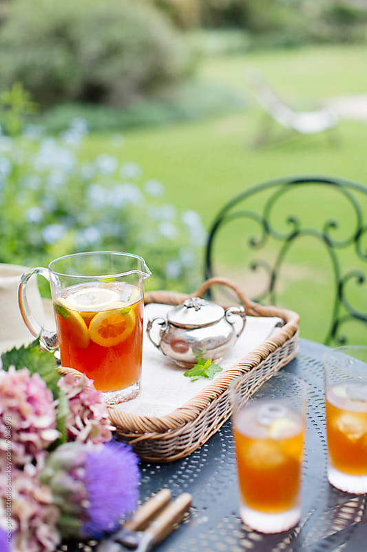 Ice tea and gardening. by mee productions for Stocksy United