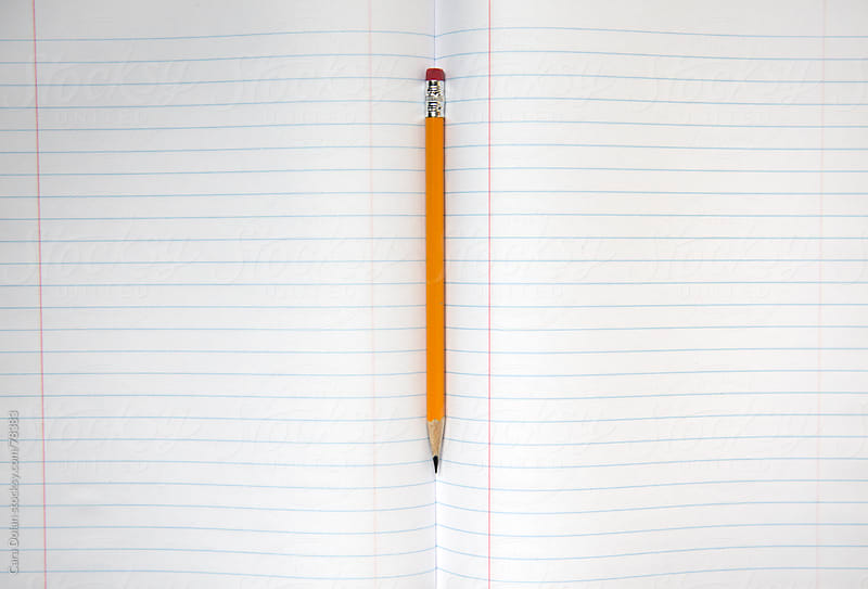 Pencil rests in the spine of a blank lined notebook by Cara Dolan for Stocksy United