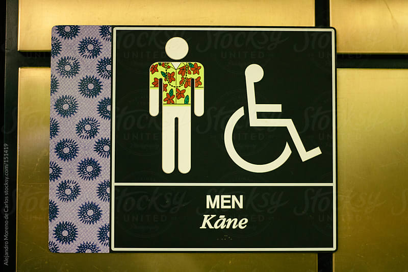 Bathroom sign with flower shirt in Honolulu, Hawaii by Alejandro Moreno de Carlos for Stocksy United