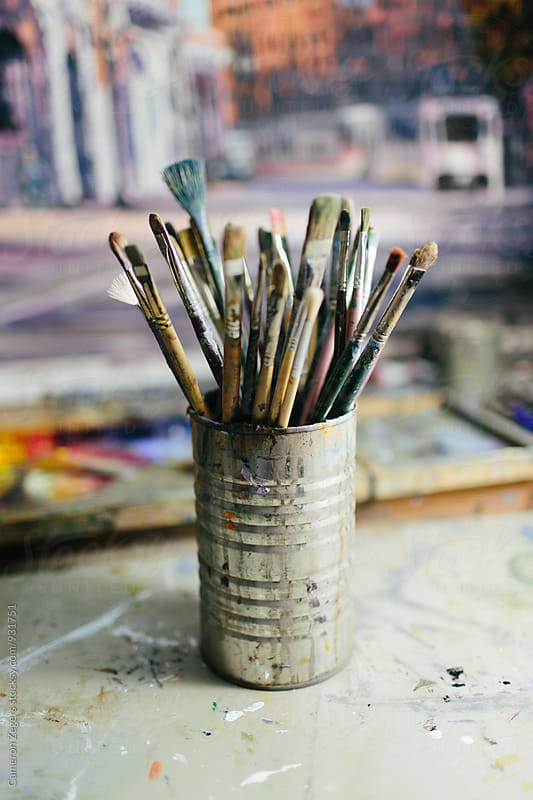 artist's brushes in studio by Cameron Zegers for Stocksy United